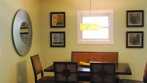 Low-VOC paints and cabinets and salvaged wood floors were a part of the green remodeling strategy.