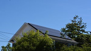 The south-facing roof is equipped with a 6.9-kW solar electric system that helps cut energy costs by nearly $2,600 annually, compared to a similar-sized home built to code.