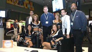 The ADFLOW Networks team enjoyed some special attention from the Silver Spurs dance team of the San Antonio Spurs. ADFLOW president David Roscoe is standing, center.