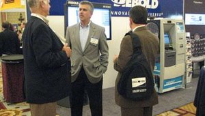 Tom Swidarski, the president and CEO of Diebold Inc., was one of ATM, Debit & Prepaid Forum's keynote speakers. At the Diebold booth, he met with some of Diebold's customers. Here Swidarski is shown talking with James Walker of PNC