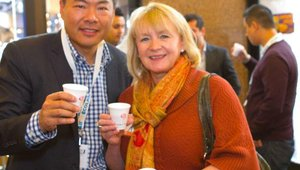Wei Bee, COO of Sweetwaters Coffee & Tea, and Vickie Grimes from Boyds Coffee, share a smoothie from Jamba Juice during the 2011 Fast Casual Executive Summit food tour.
