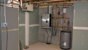 Space and water heating are both provided by a single high-efficiency, wall-mounted, gas-fired boiler. Combustion air is drawn from outside the home and exhaust gases are expelled directly to the outdoors.