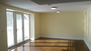 Insulated stained-concrete floors provide a water-resistant, easy-care surface and beneficial thermal mass for passive heating of the home.