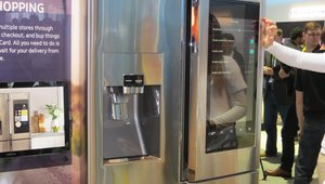"""<p><em>Samsung introduced a new refrigerator called the """"Family Hub,"""" whichis equipped with a 21.5-inch, 1080p touchscreen monitor in the right-hand door that consumers can use to shop and select items from their favorite brands. <a href=""""http://www.mobilepaymentstoday.com/articles/groceries-get-smart-with-mastercard-and-samsung/"""" target=""""_blank"""">MasterCard</a>developed a """"Groceries by MasterCard"""" app for the appliance that lets owners of the fridge add items to a virtual shopping cart, confirm their order with a four-digit PIN, and pay withany U.S.-issued credit or debit card linked to the app.</em></p>"""