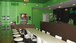 The Swich Pressed interior features a green and white color scheme and seating for about 40. The ingredients used for sandwiches are chopped fresh daily and drinks feature the brand's homemade banana lemonade.