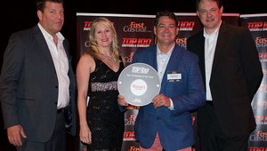 <p>Uncle Maddio's Scott Goodrich (left) and its CEO Matt Andrew receive the Top 100 award for earning the 23rd spot on the list.</p>