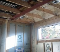 The interior basement walls are insulated with rigid foam to contribute to a continuous thermal blanket around the home.