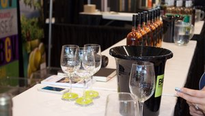 <p>Attendees sample wine at the BAR show, which coincided with NRA.</p>