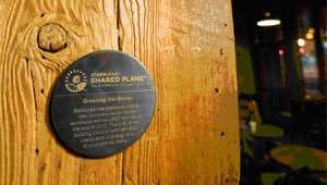 Starbucks locations built incorporating their new global design will feature a plaque labeling the new unique features.