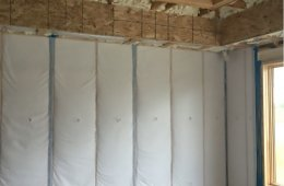 The rim joists and top plates are air-sealed and insulated with open-cell spray foam while closed-cell spray foam air seals and insulates behind tubs, showers, and fireplaces.