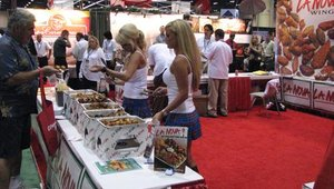 The ever-popular La Nova girls offer attendees at the 2008 Florida Restaurant and Lodging Show a taste of La Nova's chicken wing offerings.