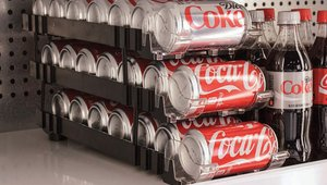 Merchandise 50% more beverage cans in the same display space with new can merchandiser