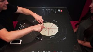 Digital signage sitting down with interactive tabletops