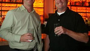 Kevin Johnson, Kokopelli Sonoran Grill, and Bob Dames, Visual Graphic Systems Inc., enjoy the Summit cocktail and networking reception.