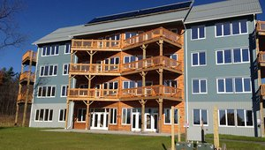 AquaZephyr, LLC, built this 22,600-square-foot, 15-unit multifamily building in Ithaca, New York, to the performance criteria of the U.S. Department of Energy Zero Energy Ready Home (ZERH) program. The angular decks and entry area were designed to increase the amount of southern exposure for passive solar gain.