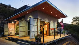 Lakeside Container Cottage, San Diego, Calif. This 720 sq. ft home was built with used shipping containers. The designer used furring strips to create a gap between the container wall and metal studs to prevent thermal bridging, and closed-cell polyurethane foam sprayed in the void behind the drywall achieved an R-14 rating. The foam insulation provides an R-7 thermal rating per inch and acts as a moisture and air barrier to prevent condensation in the wall cavity.  Photo by Kevin Walsh Photography
