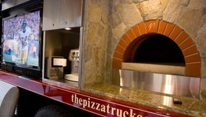 The Pizza Truck Co. displayed its imported Italian wood-burning oven, 60-inch flatscreen HDTV and DirecTV Satellite reception options.