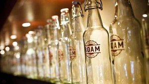 Adorning the shelves behind the bar are Roam-branded soda bottles. The restaurant makes its own brand of carbonated beverages that features four signature varieties. Sodas include Meyer Lemon, Ginger Lime, Prickly Pear and Caramelized Pineapple.