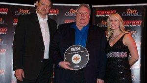 <p>Bentley Hetrick of Fatburger receives the brand's Top 100 award.</p>