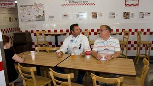 Rory Millikin and George Green, vice president of Bread and Company, shared a table while waiting for their food at Five Guys Burgers & Fries.