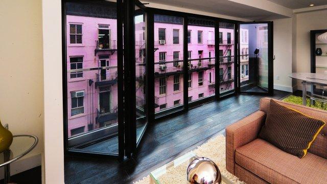 Renovated Tenement Features Window Walls