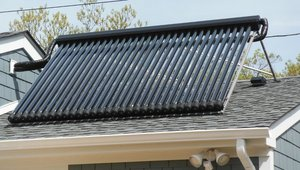 <p>The solar water heater includes two 30-tube evacuated tube panels and a 120-gallon storage tank with electric backup.</p>