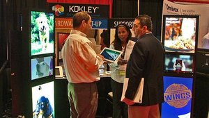 CETW GM Lawrence Dvorchik (right) stopped by the Kokley booth showcasing digital signage kiosks.