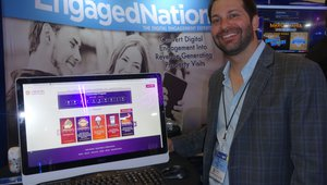 Michael Poulos demonstrates a kiosk that promotes marketing incentives in casinos at the Engaged Nation exhibit.