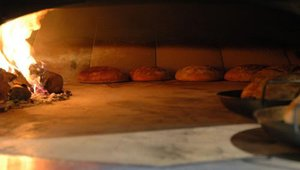The intense heat generated by a stone hearth oven imparts a unique flavor to food.