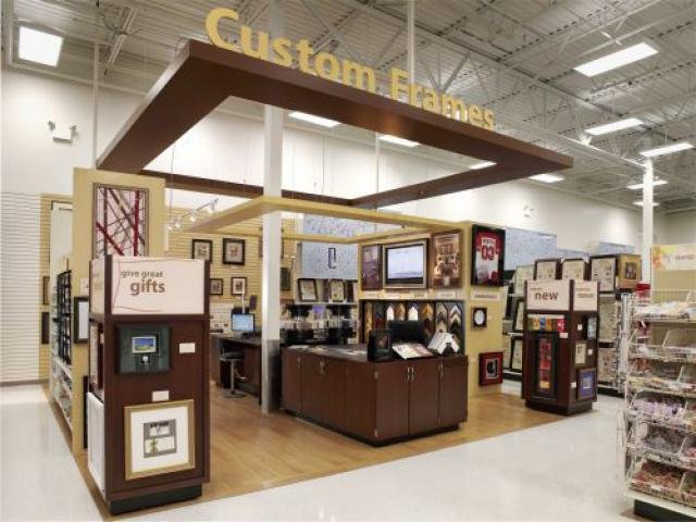 custom framing is a key destination in the store a center island encourages a hands