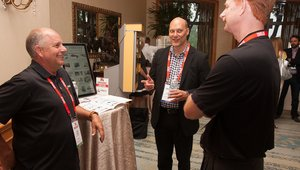 <p>The secret sauce of the summits is the conversations and relationships that are developed. Here, Irv Cassio, senior systems architect for Luxottica Retail Center) talks to fellow attendees and exhibitors.</p>