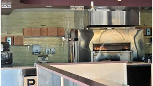 Owner James Markham spent hours researching the oven industry until he found this open-flame oven to cook his pizzas at 800 degrees in under 2 minutes. 