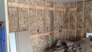 The exterior walls are filled with a mold-resistant glass mineral wool insulation then covered with a coated OSB sheathing plus a fire-rated mineral wool foam board, plus two inches of foil-faced rigid polyisocyanurate.
