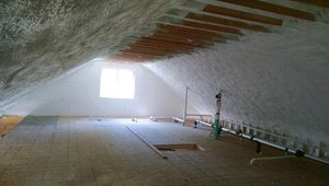 The attics are insulated to R-64 with a hybrid application of 11 inches of open-cell spray foam (R-4.45/in) plus 2 inches of closed-cell spray foam (R-7.4/in) that completely fills the roof rafter cavities and encases the rafters creating a continuous blanket of insulation across the attic ceiling.