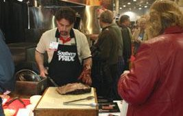 Jerry Yoho prepared succulent meat from Southern Pride. We hear it tasted as good as it looked and smelled.