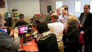 A group of payments journalists visit a Tim Hortons coffee shop in downtown Toronto to see MasterCard's mobile wallet in action.