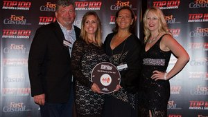 <p>JJ's Red Hots Founder Jonathan Luther, his wife, Melissa and the chain's director of marketing, Brandi Newton, pose with Cherryh Butler, editor of FastCasual.com, after receiving their award.</p>