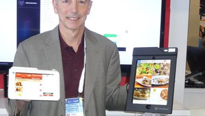 Mike Bauer presents the i-Pad and Android tablets from eTouchMenu at the House Advantage booth.