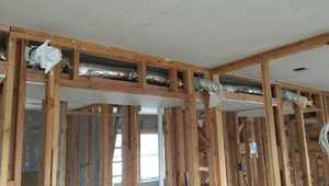 The HVAC ducts are located inside the home in dropped ceiling chases where they are protected from the elements.