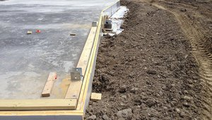 Two layers of rigid foam insulation wrap the foundation slab, helping to keep floors warm in the winter.