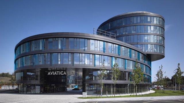 Prague office building showcases glass facade proud for 937 design hotel prague