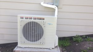 This compact outside unit for the ultra-efficient air-to-water heat pump (COP 4.1) provides space heating and domestic hot water. The heat pump could also provide cooling, but the house is designed so that thermal mass and ventilating exhaust fans with timer controls remove most of the unwanted heat from the home during the few high-temperature days in the mild Northwest climate.