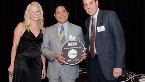 Joe Chum (center) accepts the No. 15 award from FastCasual.com editor Cherryh Butler and Chris Trout from Henny Penny.