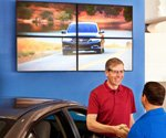 How digital signage drives sales in auto dealerships