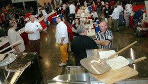 Contestants and volunteers crowded the makeshift kitchen and prep area at NAPICS for the North American Pizza Pizzazz competition.
