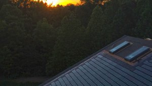 Power production from the integrated solar shingles helps cut electric bills to $71 a month.