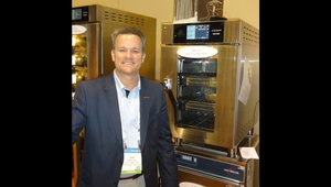 Bob Dellert presents a 3-compartment oven that can go on food trucks at the Alto Shaam Inc. booth.