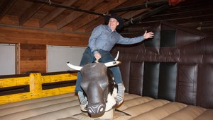 "<p><span style=""line-height: 20.8px;"">Infusion's Brandon Elliott braved the mechanical bull (and showcased those socks!) at the party following the awarding of this year's ICX Association Elevate Awards at the Circle R Ranch.</span></p>"
