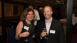 Kathy Doyle, publisher of Networld Media Group, and David Drain, the company's VP of Events toast to the Summit.