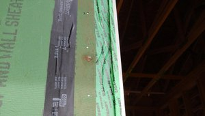 Specific tapes are selected to cover seams in the wall sheathing and to provide water-repellent flashing around windows and doors.